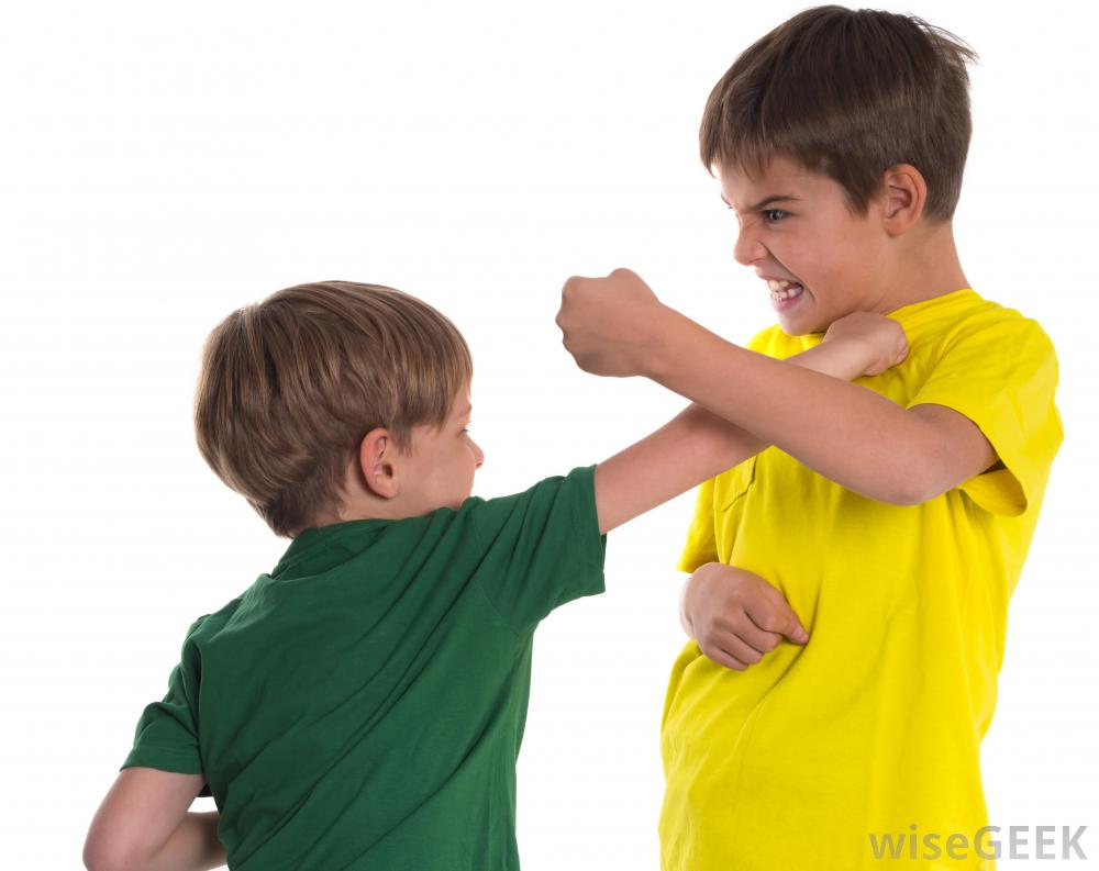 two boys fighting on white